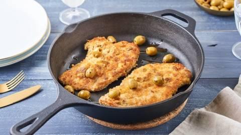 Escalope de veau panée en croûte de parmesan et olives vertes