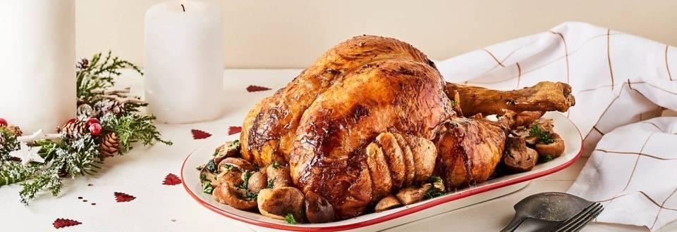 Chapon de Noël farci au foie gras et sa poêlée de cèpes